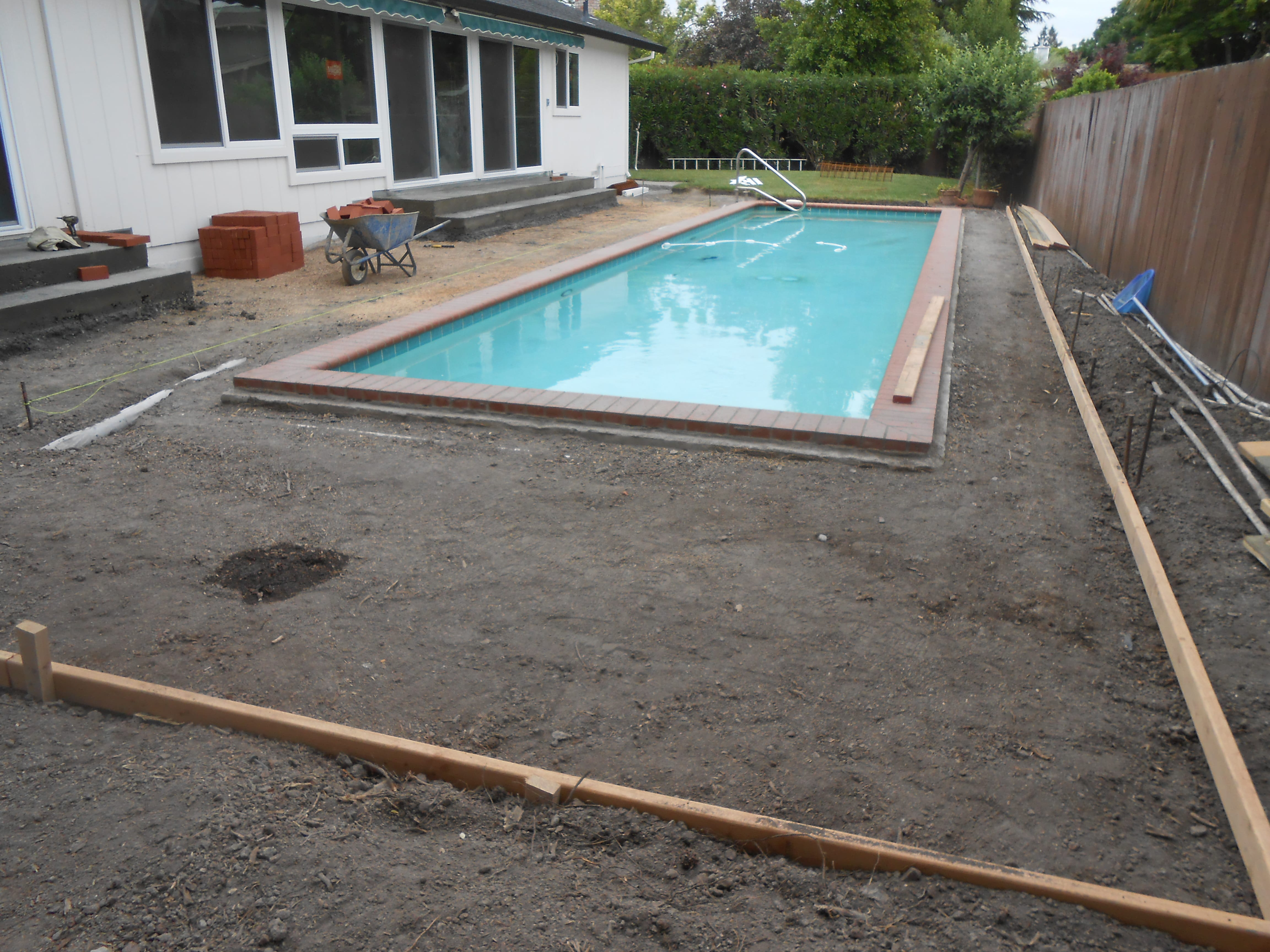 Preparing the area for brick installation in a pool deck
